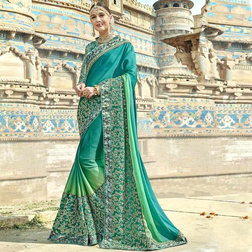 Breathtaking Teal Green Colored Partywear Embroidered Georgette Saree