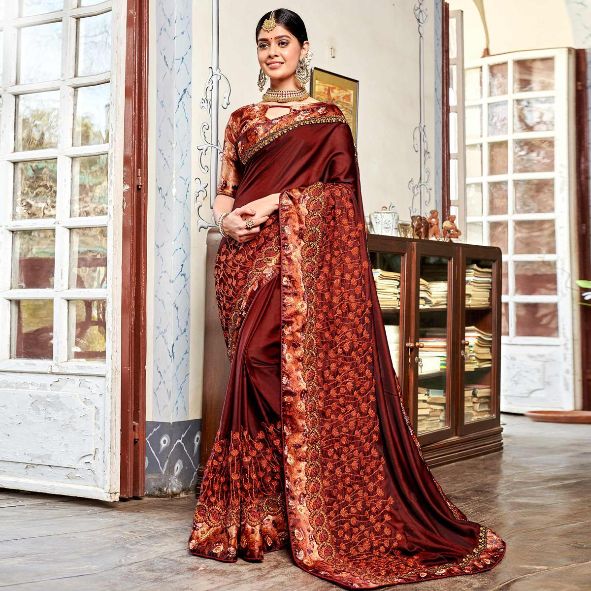 Jazzy Brown Colored Partywear Embroidered Georgette Saree