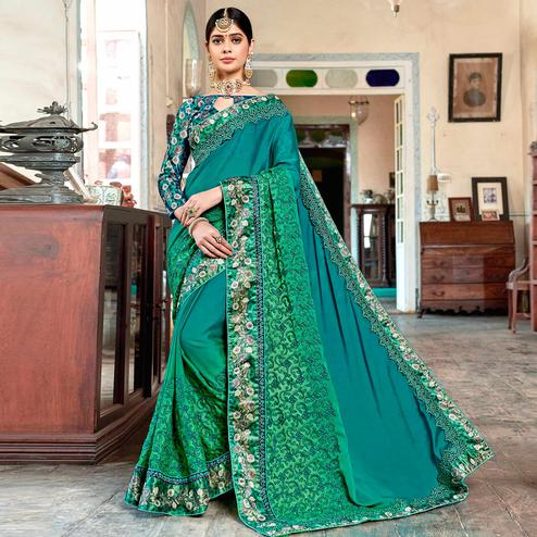 Engrossing Teal Green Colored Partywear Embroidered Georgette Saree