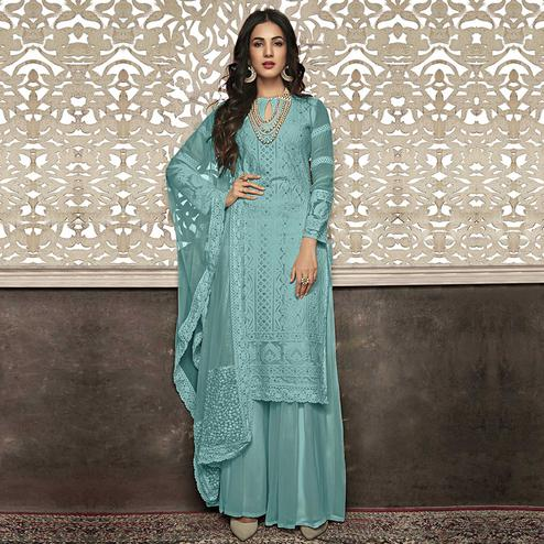 Magnetic Sky Blue Colored Partywear Embroidered Faux Georgette Palazzo Suit