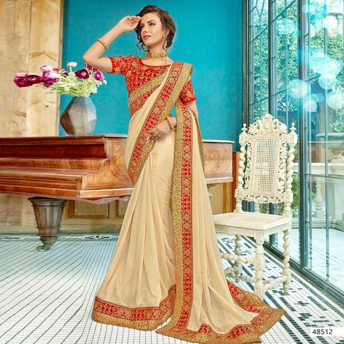 Blissful Cream Colored Partywear Embroidered Georgette Saree