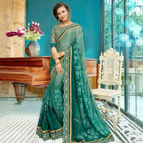 Imposing Teal Green Colored Partywear Embroidered Georgette Saree