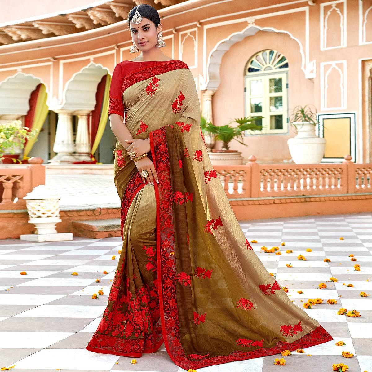 Intricate Beige Colored Partywear Embroidered Georgette Saree