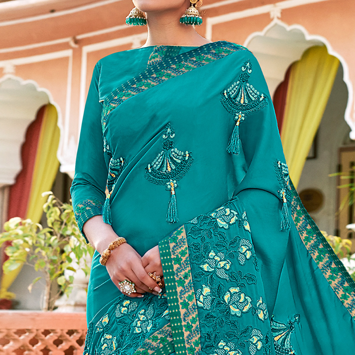 Exotic Sky Blue Colored Partywear Embroidered Georgette Saree