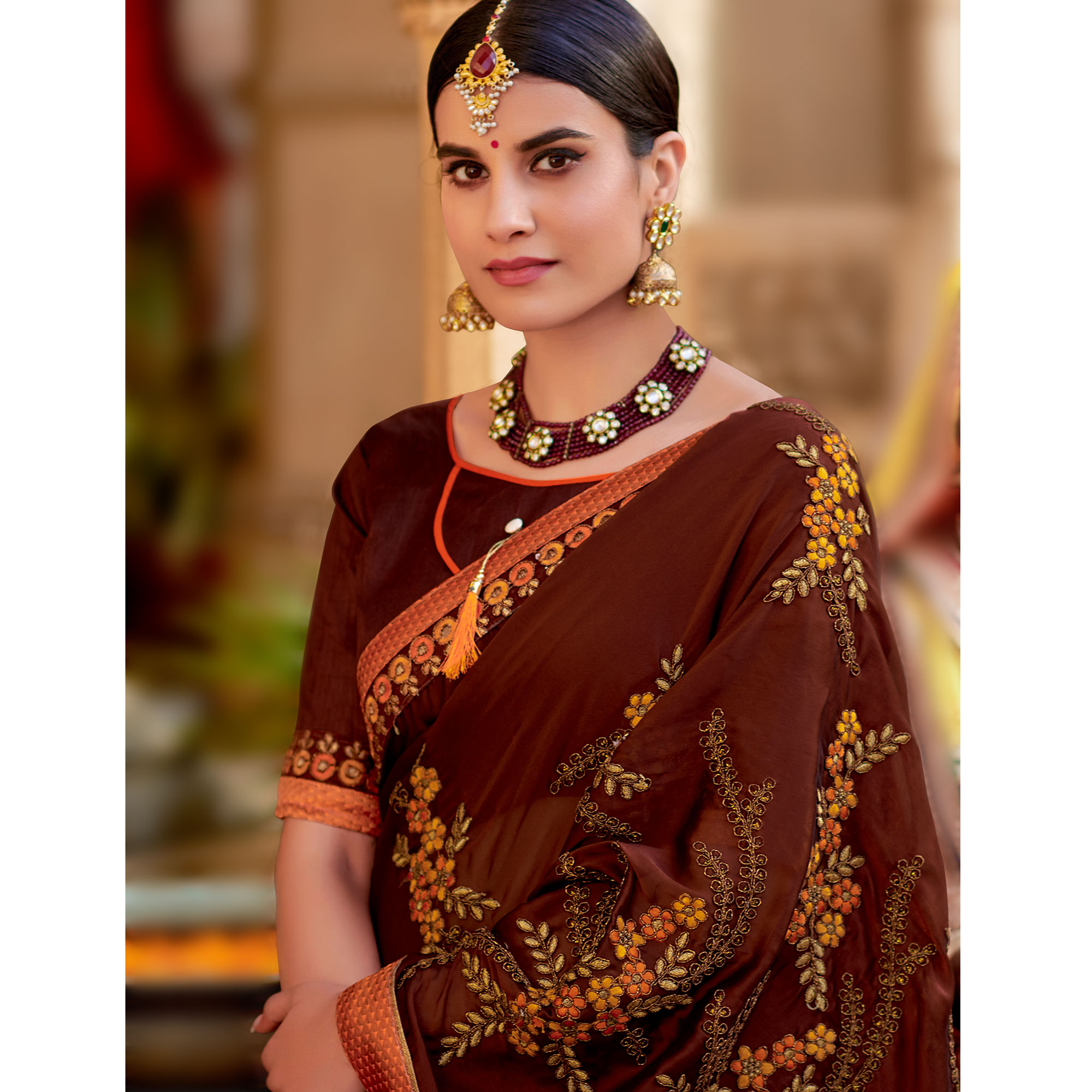 Trendy Brown Colored Partywear Embroidered Georgette Saree