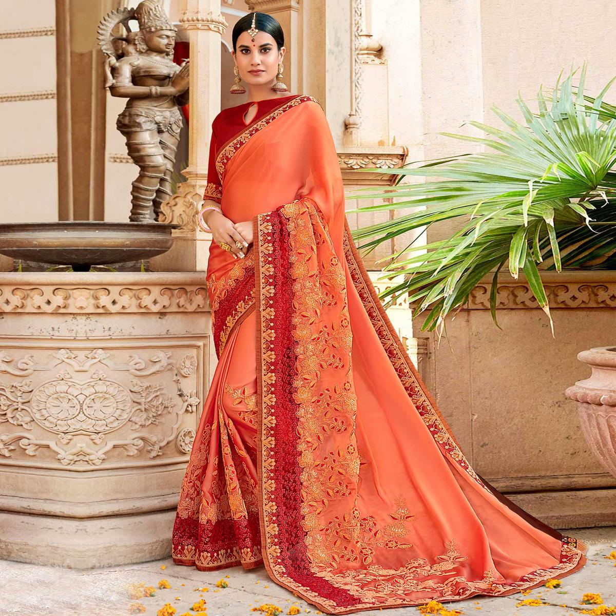 Elegant Orange Colored Partywear Embroidered Georgette Saree