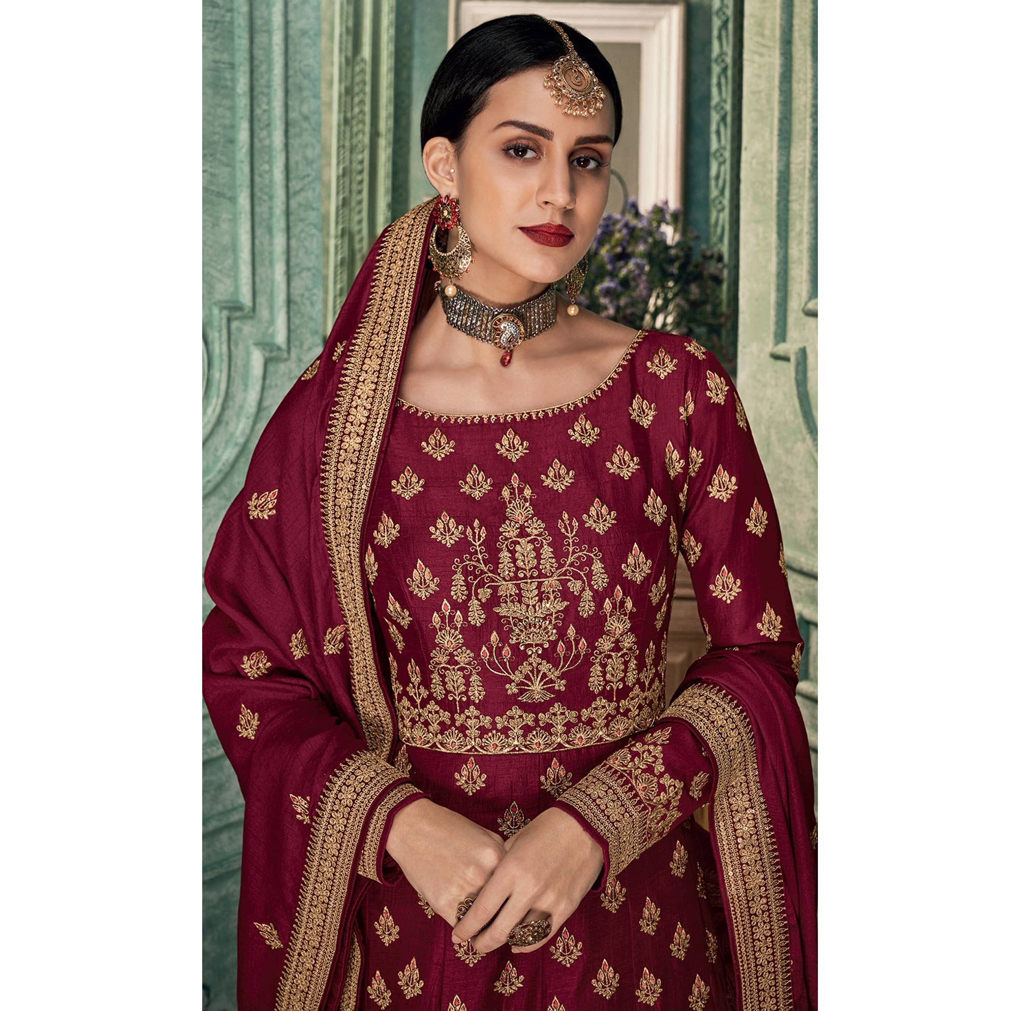 Appealing Maroon Colored Partywear Embroidered Silk Anarkali Suit