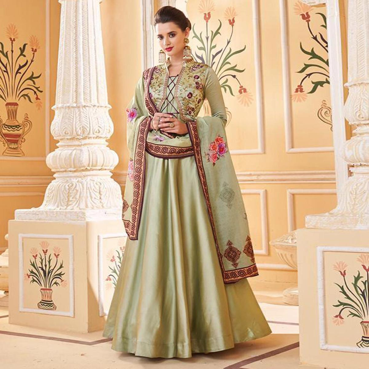 Flattering Light Green Colored Partywear Embroidered Silk Anarkali Suit