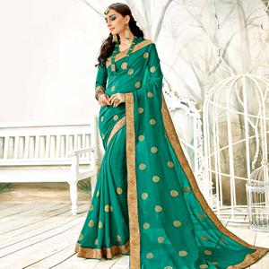 Magnetic Rama Green Colored Partywear Embroidered Georgette Saree