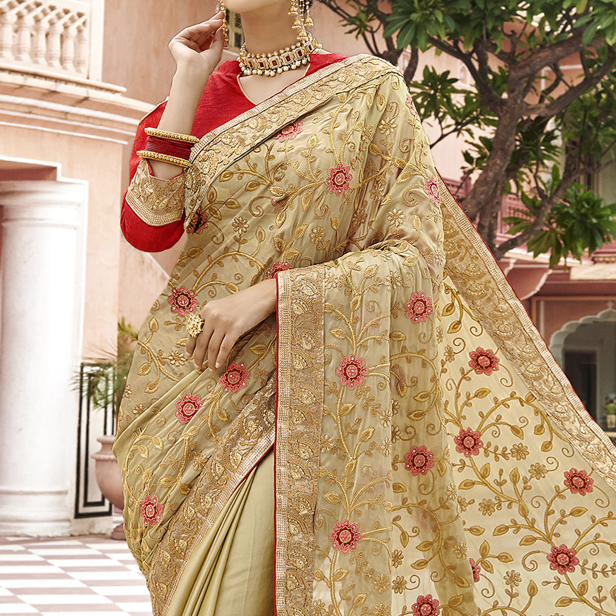 Dazzling Beige Colored Party Wear Embroidered Georgette Saree