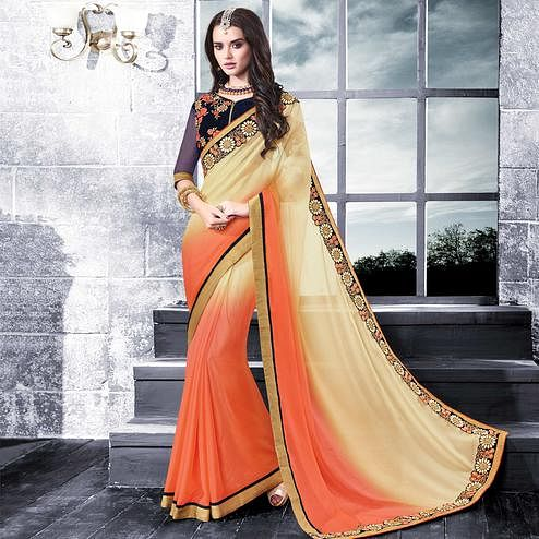 Blooming Beige-Peach Colored Partywear Embroidered Georgette Saree