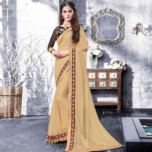 Beautiful Chiku Colored Partywear Embroidered Georgette Saree
