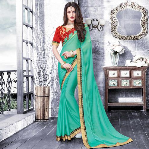 Adorable Aqua Green Colored Partywear Embroidered Georgette Saree