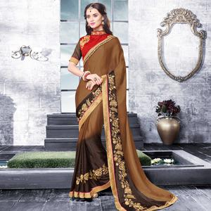 Desirable Brown Colored Partywear Embroidered Georgette Saree