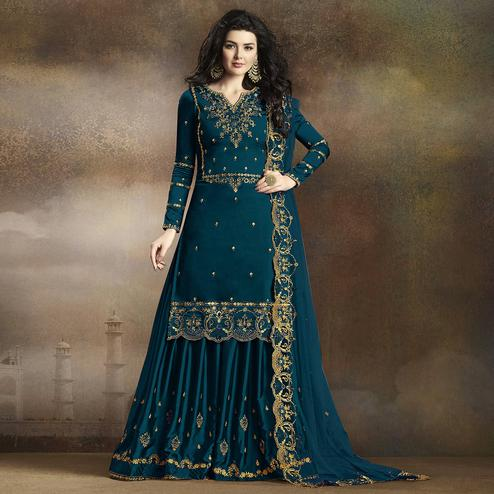 Alluring Rama Blue Colored Partywear Embroidered Georgette Palazzo Suit