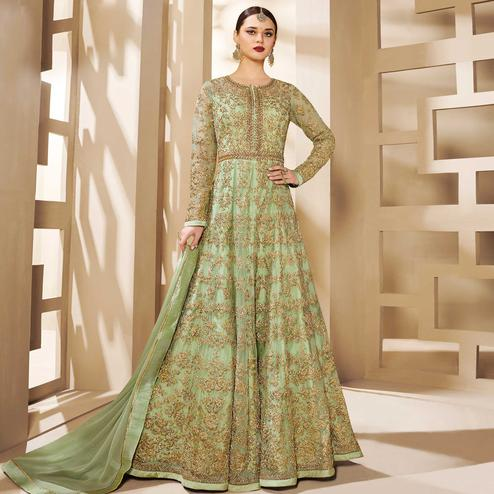 Dazzling Pastel Green Colored Partywear Embroidered Netted Anarkali Suit