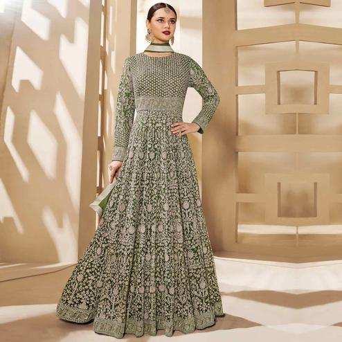 Surpassing Dark Green Colored Partywear Embroidered Netted Anarkali Suit
