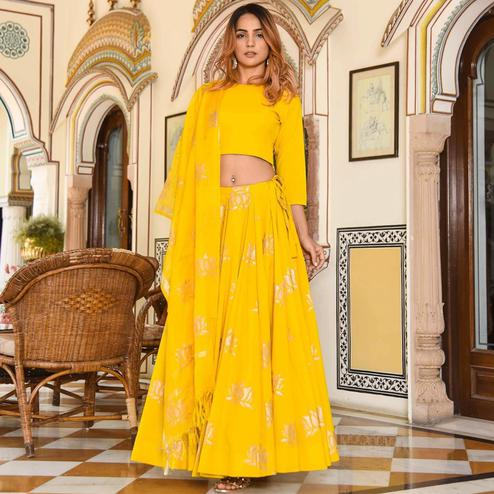 Prominent Yellow Colored Partywear Foil Printed Rayon Lehenga Choli