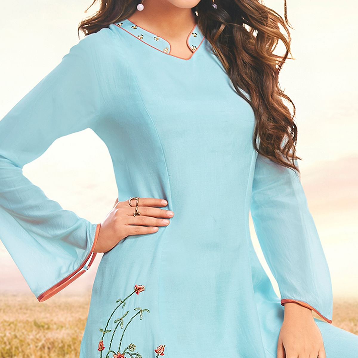 Ideal Sky Blue Colored Partywear Embroidered Cotton Silk Fancy Kurti