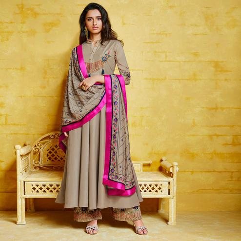 Lovely Grey Colored Partywear Embroidered Muslin Palazzo Suit