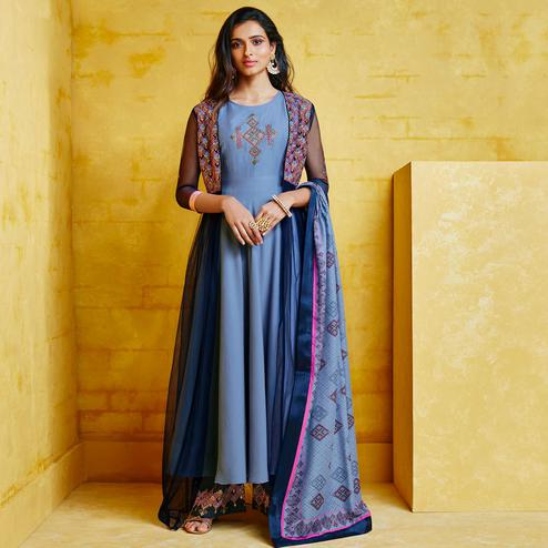 Imposing Blue Colored Partywear Embroidered Muslin Palazzo Suit