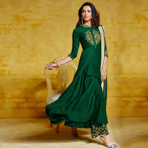 Ideal Dark Green Colored Partywear Embroidered Muslin Palazzo Suit