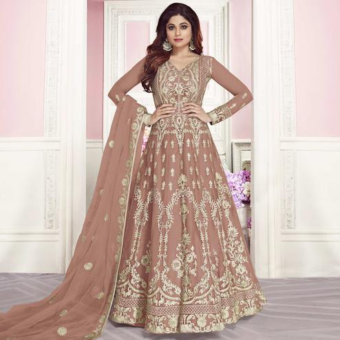Magnetic Mauve Colored Partywear Embroidered Silk Anarkali Suit