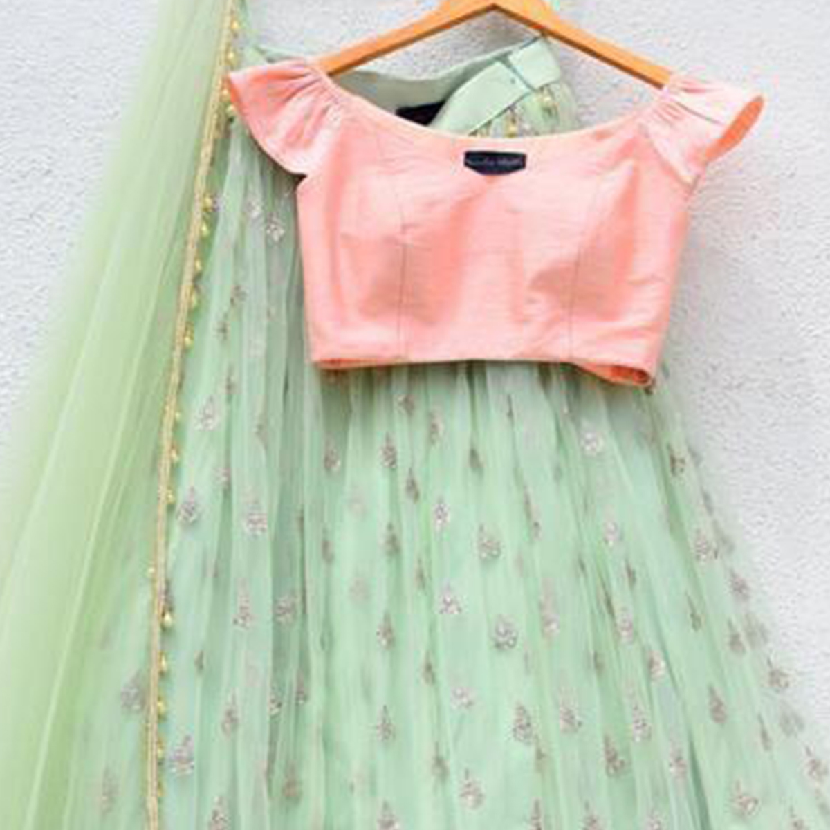 Amazing Mint Green Colored Partywear Embroidered Georgette Lehenga Choli
