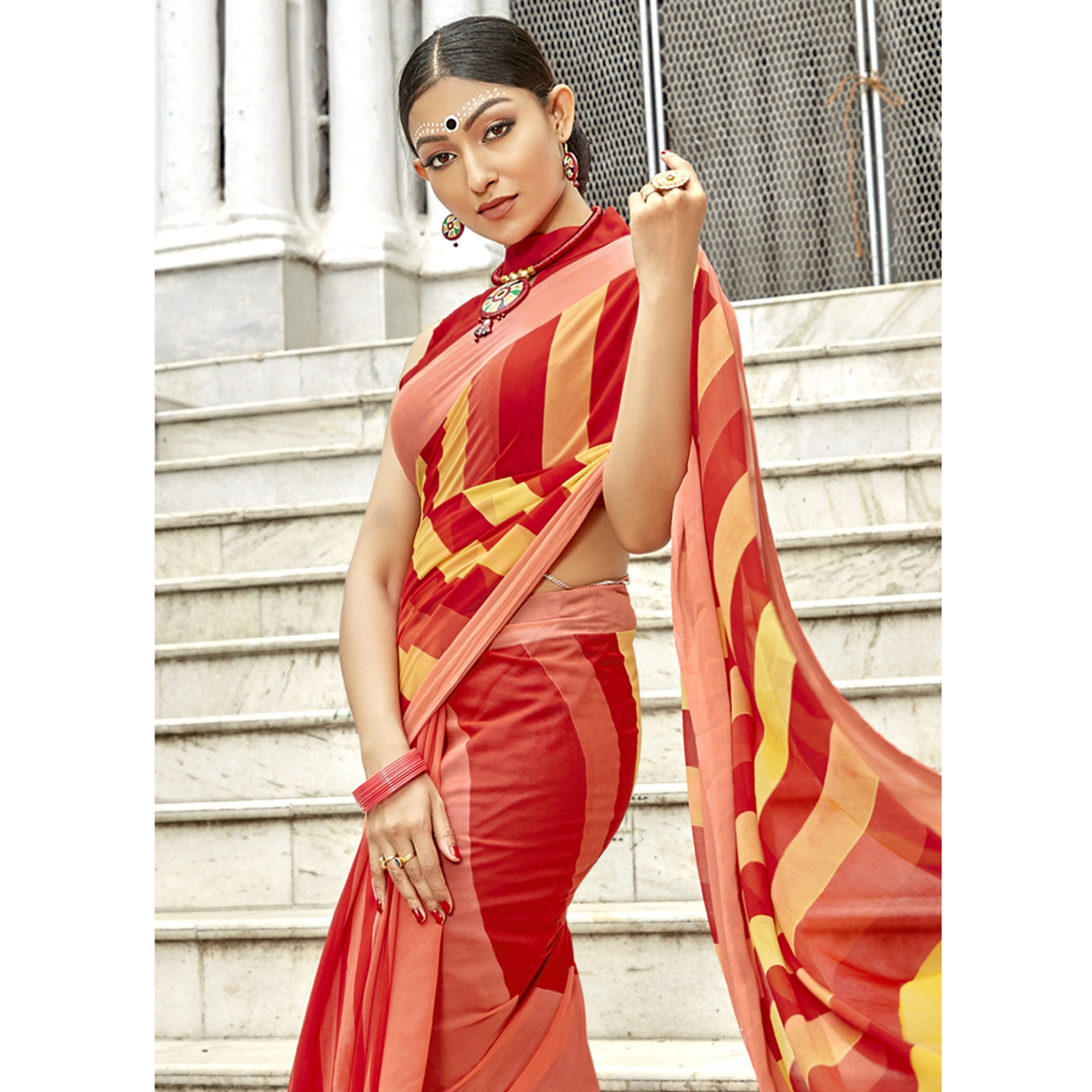 Capricious Red-Peach Colored Casual Printed Georgette Saree