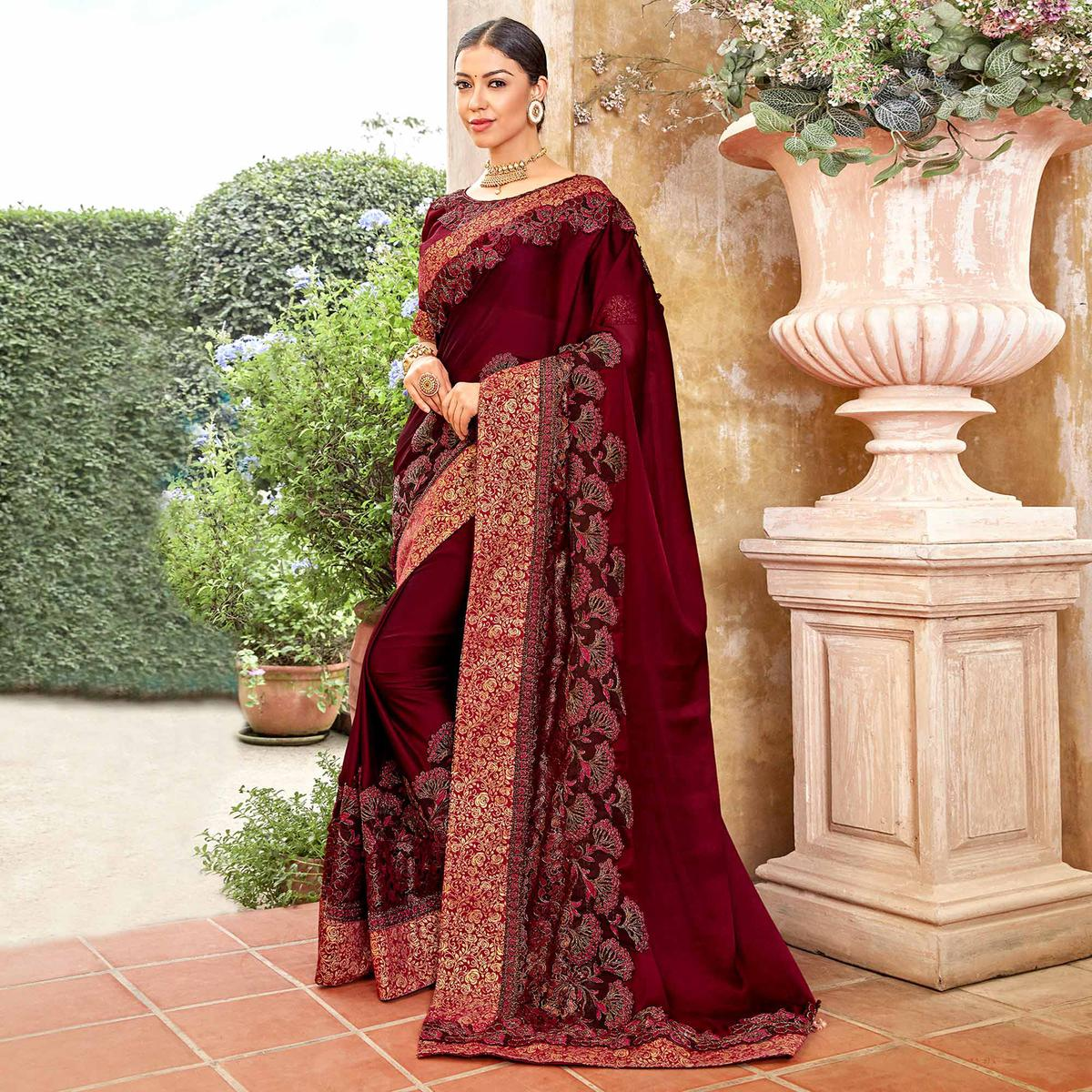Sophisticated Wine Colored Partywear Embroidered Georgette Saree
