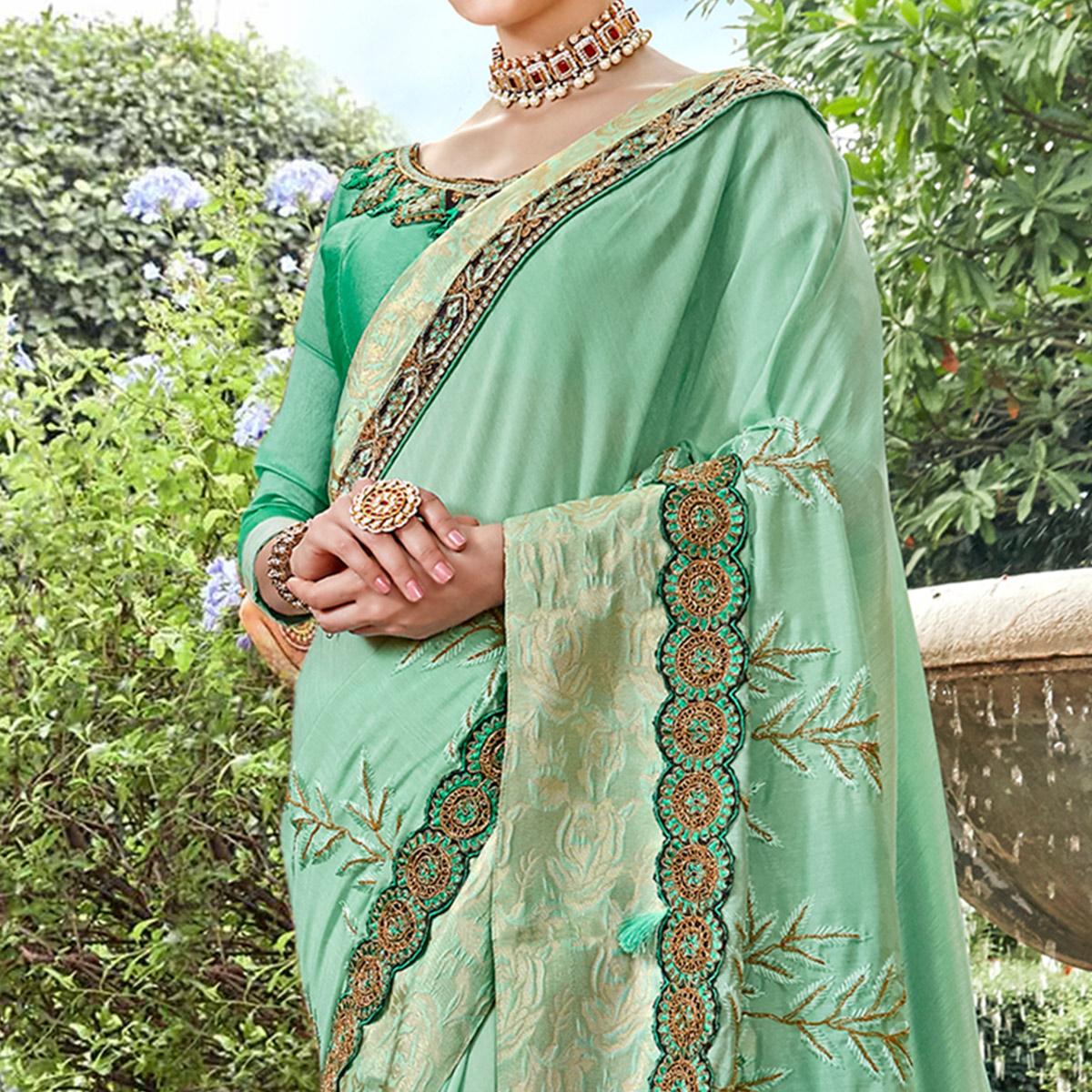 Exotic Aqua Green Colored Partywear Embroidered Georgette Saree