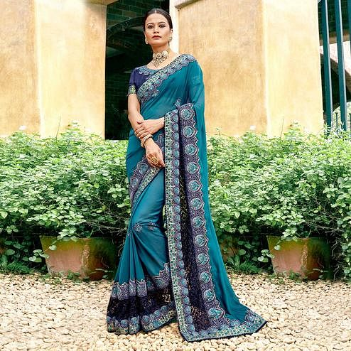 Arresting Sky Blue Colored Partywear Embroidered Georgette Saree