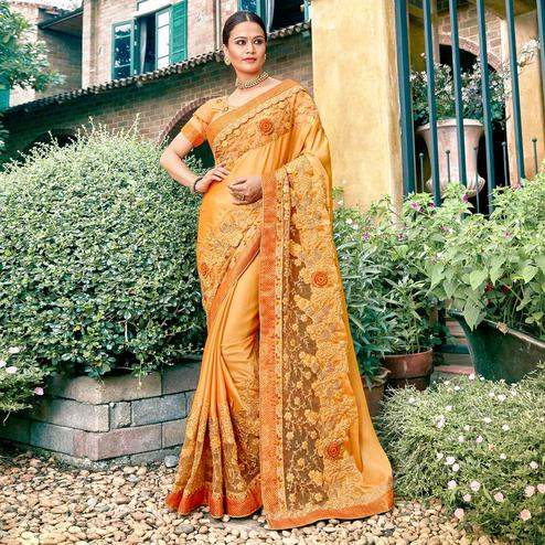 Intricate Light Orange Colored Partywear Embroidered Georgette Saree