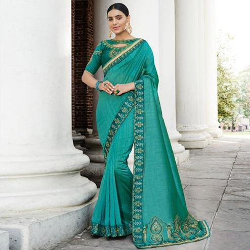 Hypnotic Turquoise Green Colored Partywear Embroidered Art Silk Saree