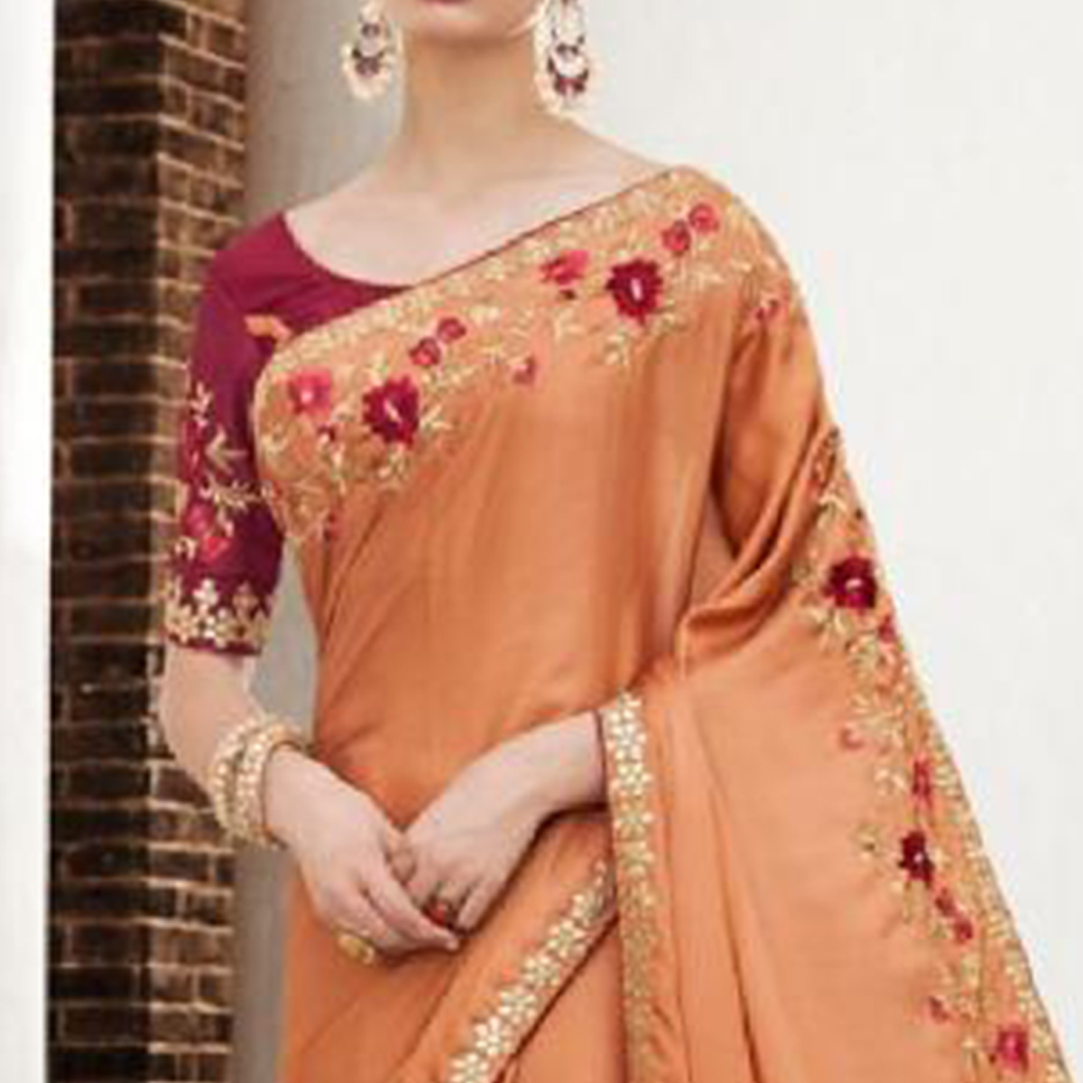 Flattering Peach Colored Partywear Embroidered Georgette-Silk Saree