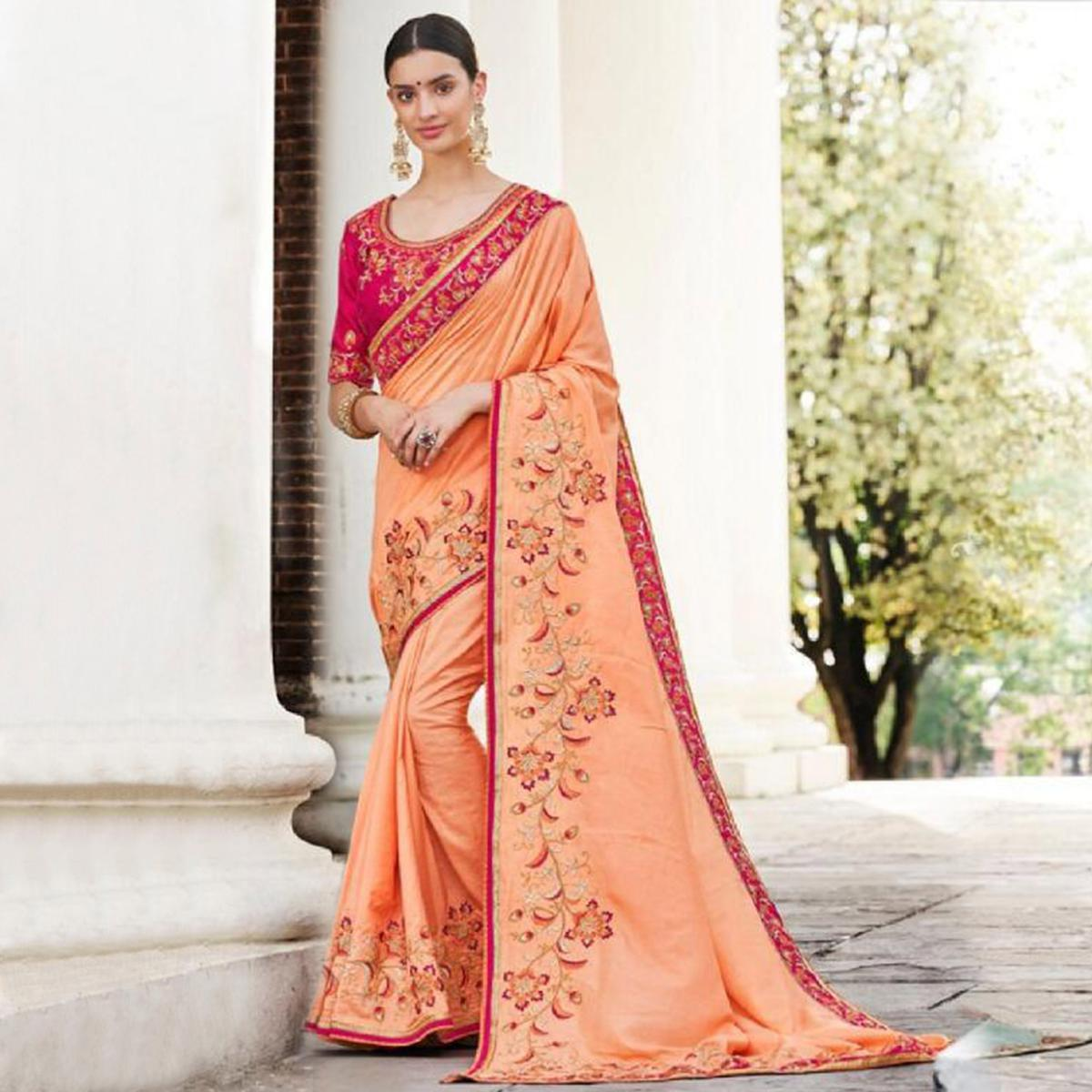 Flamboyant Peach Colored Partywear Embroidered Art Silk Saree