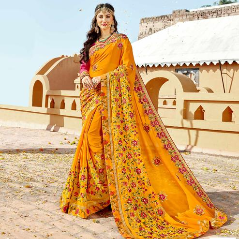 Delightful Yellow Colored Partywear Embroidered Georgette Saree