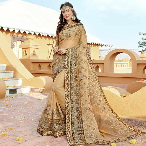 Engrossing Beige Colored Partywear Embroidered Georgette Saree