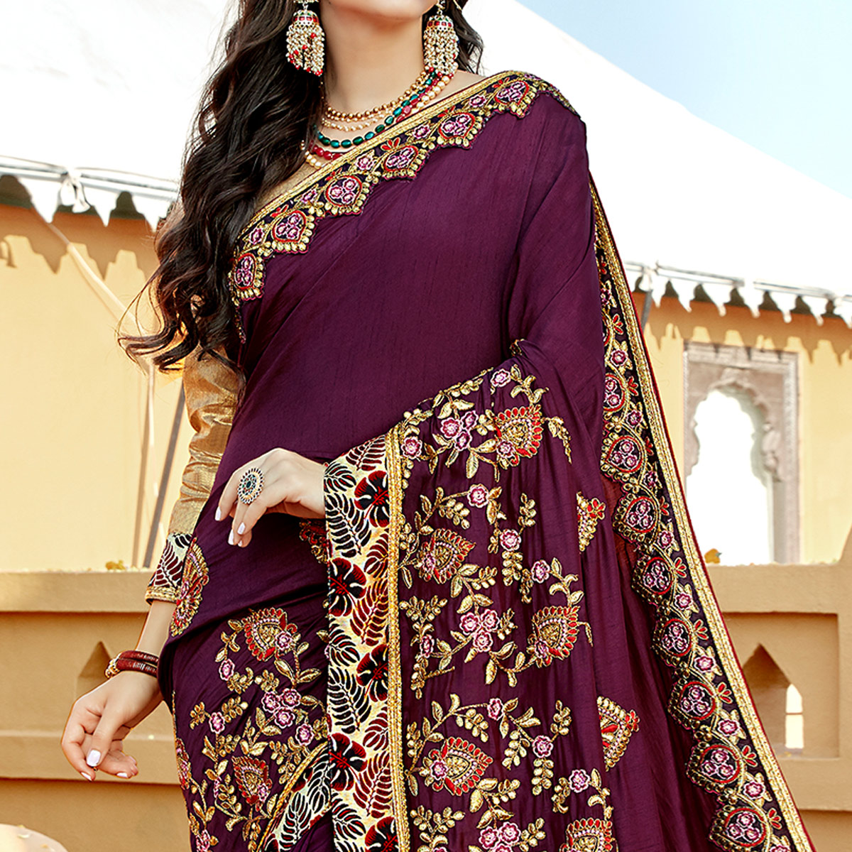 Captivating Purple Colored Partywear Embroidered Georgette Saree