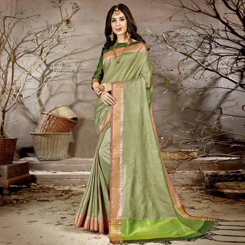 Gorgeous Light Green Colored Festive Wear Woven Chanderi Silk Saree