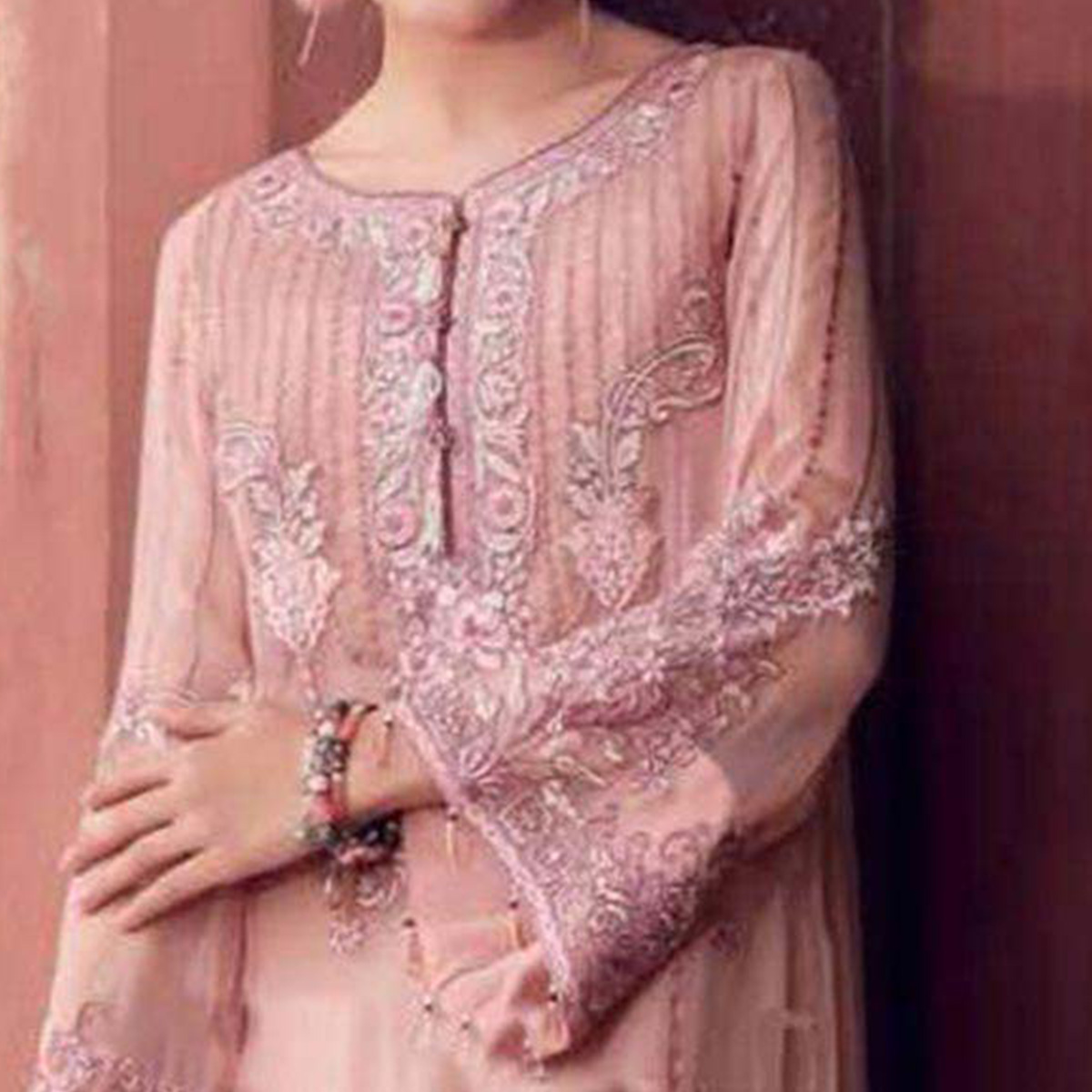 Flattering Pink Colored Partywear Embroidered Georgette Suit
