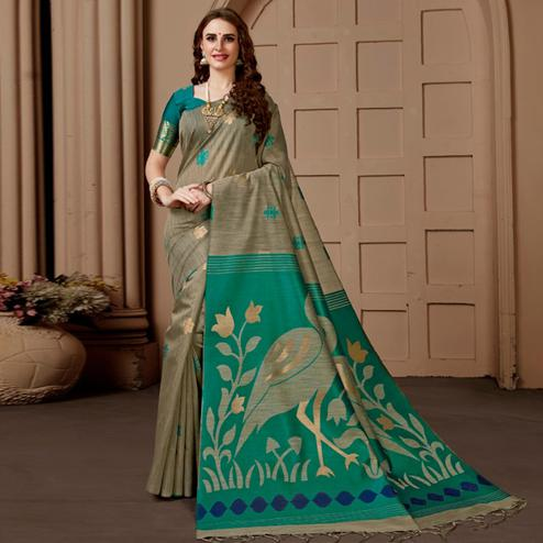 Flattering Chiku-Turquoise Green Colored Festive Wear Woven Art Silk Saree