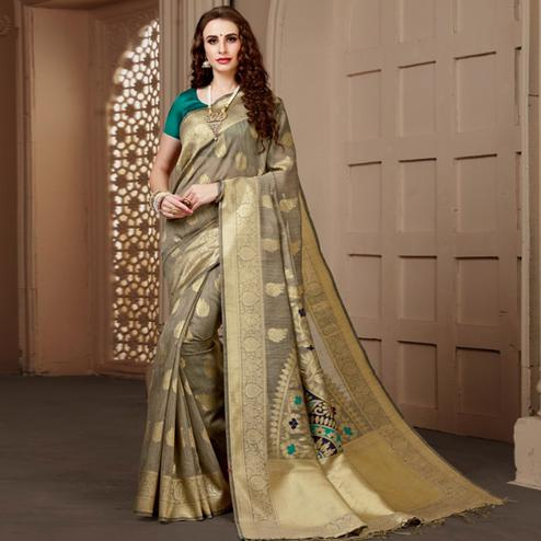 Flamboyant Chiku Colored Festive Wear Woven Art Silk Saree