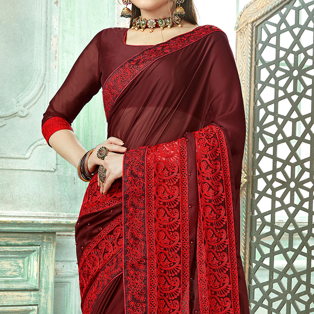 Innovative Maroon Colored Partywear Embroidered Georgette Saree