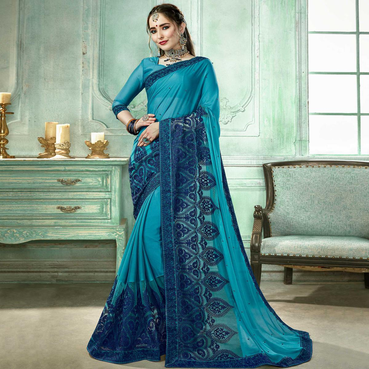 Eye-catching Sky Blue Colored Partywear Embroidered Georgette Saree