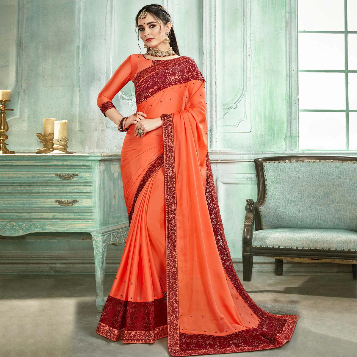 Fantastic Peach Colored Partywear Embroidered Georgette Saree