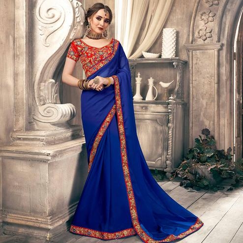 Eye-catching Blue Colored Partywear Embroidered Georgette Saree
