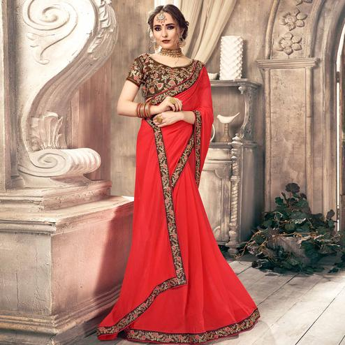 Gleaming Coral Red Colored Partywear Embroidered Georgette Saree