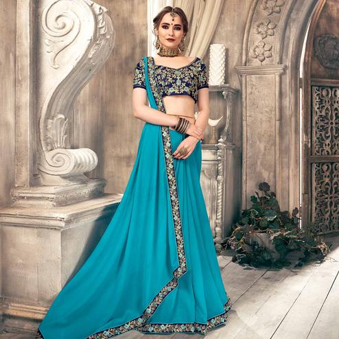 Gorgeous Sky Blue Colored Partywear Embroidered Georgette Saree