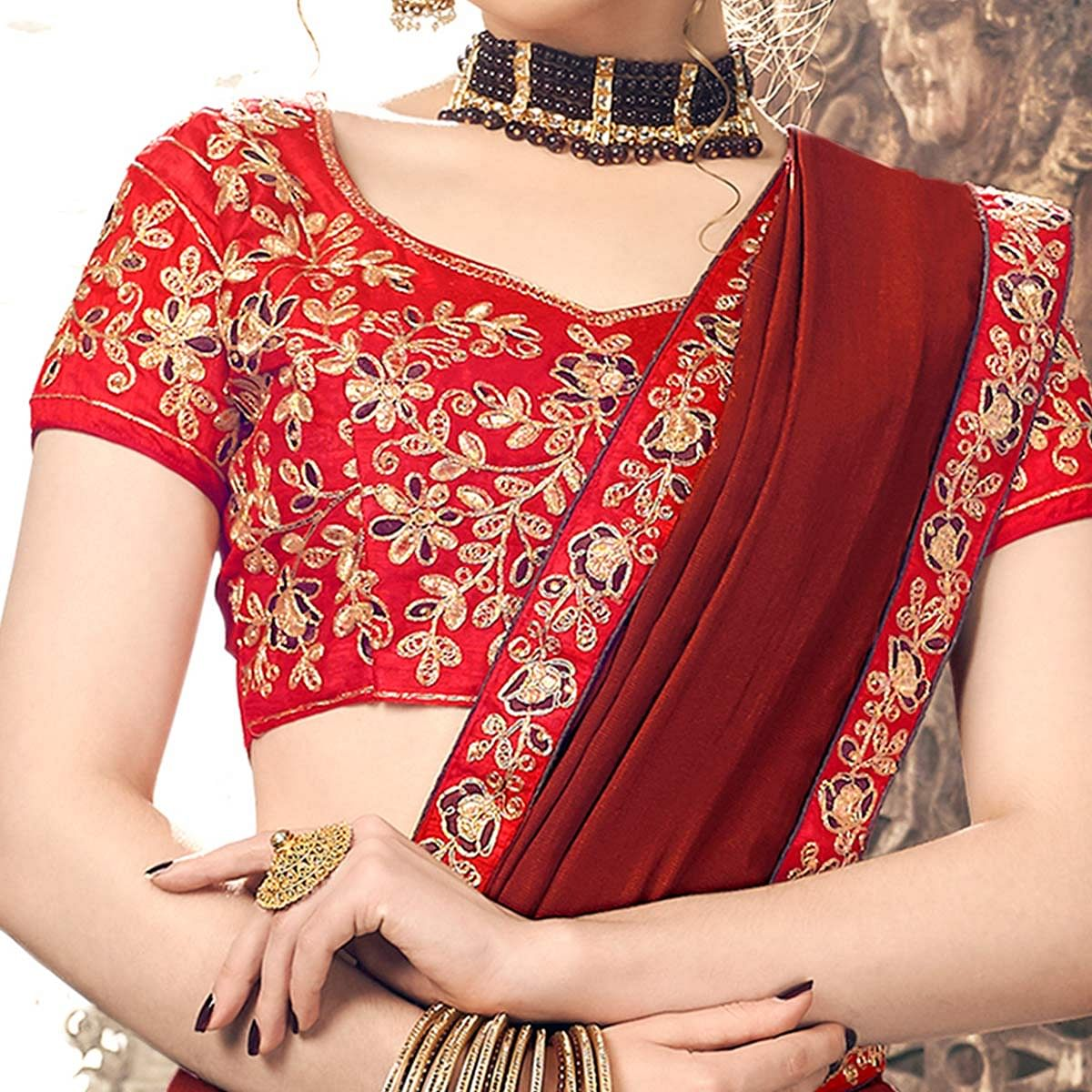 Unique Maroon Colored Partywear Embroidered Georgette Saree